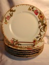 A lovely set of Antique Limoges Wild Flower Plates Jean Pouyat
